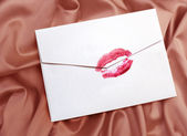 Envelope with lipstick kiss — Stock Photo