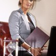 Businesswoman with folder - Stock Photo