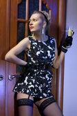 Rich woman in black dress — Stock Photo