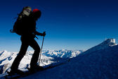 Ski touring in high mountains — Stock Photo