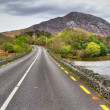 Irish road with mountain view — Stock Photo