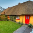 Stock Photo: Traditional cottage house in Adare