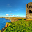 Stock Photo: Ruins of old castle on Cliffs of Moher