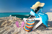 Deckchair with sun accessories on the Caribbean beach — Stock Photo
