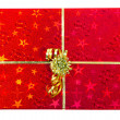 Red gift box with golden ribbon — Stock Photo