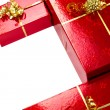 Red gift boxes with golden ribbon — Stock Photo