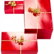 Red gift boxes with golden ribbon — Stock Photo #8060186