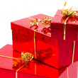 Red gift boxes with golden ribbon — Stock Photo #8102647