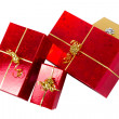Red gift boxes with golden ribbon — Stock Photo #8102655