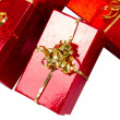 Red gift boxes with golden ribbon — Stock Photo #8102663