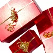 Red gift boxes with golden ribbon — Stock Photo #8102672