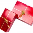 Red gift boxes with golden ribbon — Stock Photo #8102678