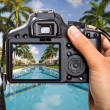 Camera in hand on tropical holidays — Stock Photo #8102743