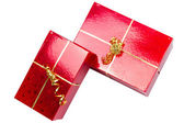 Red gift boxes with golden ribbon — Photo