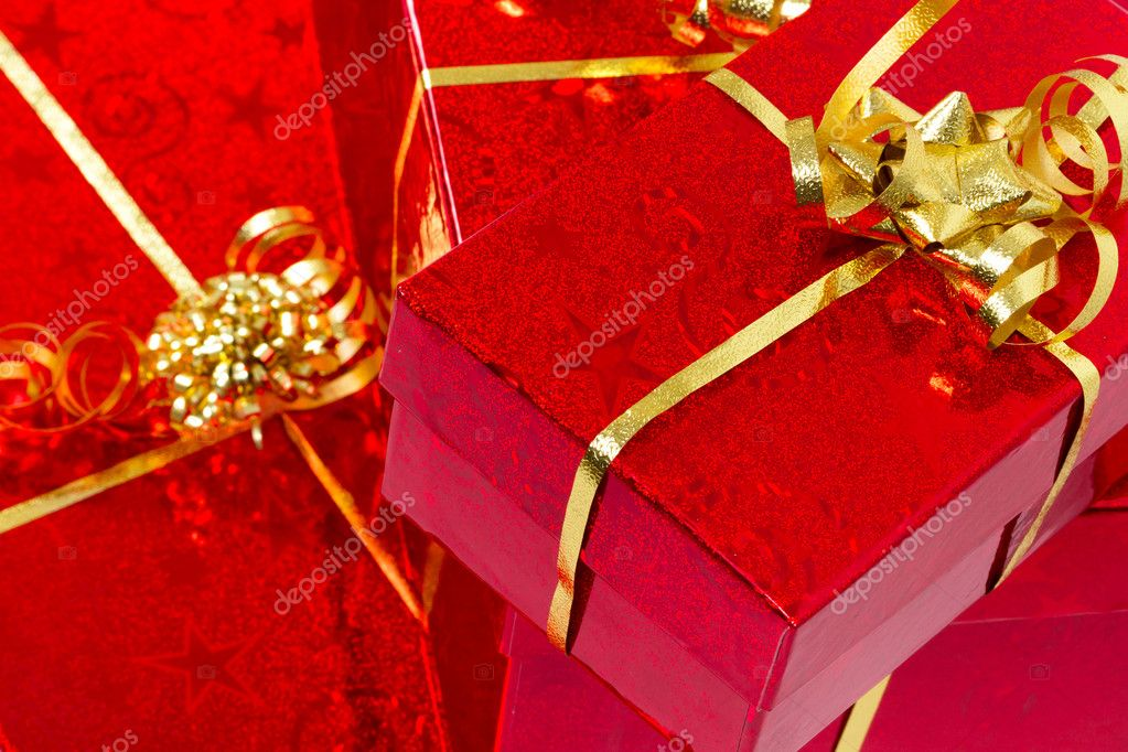 Red gift boxes with golden ribbon — Stock Photo #8102642