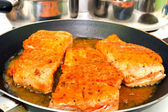 Frying salmon on the pan — Stock Photo