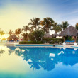Tropical swimming pool at sunrise — Stockfoto #8430378
