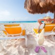 Relaxation under parasol at Caribbean Sea — Stock Photo