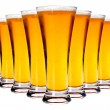 Stock Photo: Line of glasses with lager beer