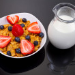 Stock Photo: Corn flakes and fresh fruits for breakfast