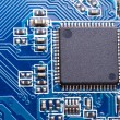 Micro chip on the computer motherboard - Stock Photo