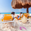 Holidays under parasol - Stock Photo