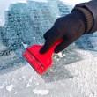 Stock Photo: Scraping ice