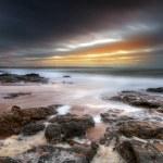 Rocky landscape of Atlantic ocean at sunset — Stock Photo