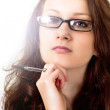 Beautiful brunette in reading glasses — Stock Photo