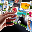 Hand reaching streaming multimedia — Stock Photo