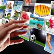 Stock Photo: Hand reaching streaming multimedia