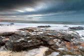 Rocky landscape of Atlantic ocean at sunset — Stockfoto