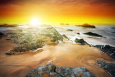 Rocky landscape of Atlantic ocean at sunset — Foto Stock