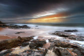 Rocky landscape of Atlantic ocean at sunset — Stok fotoğraf