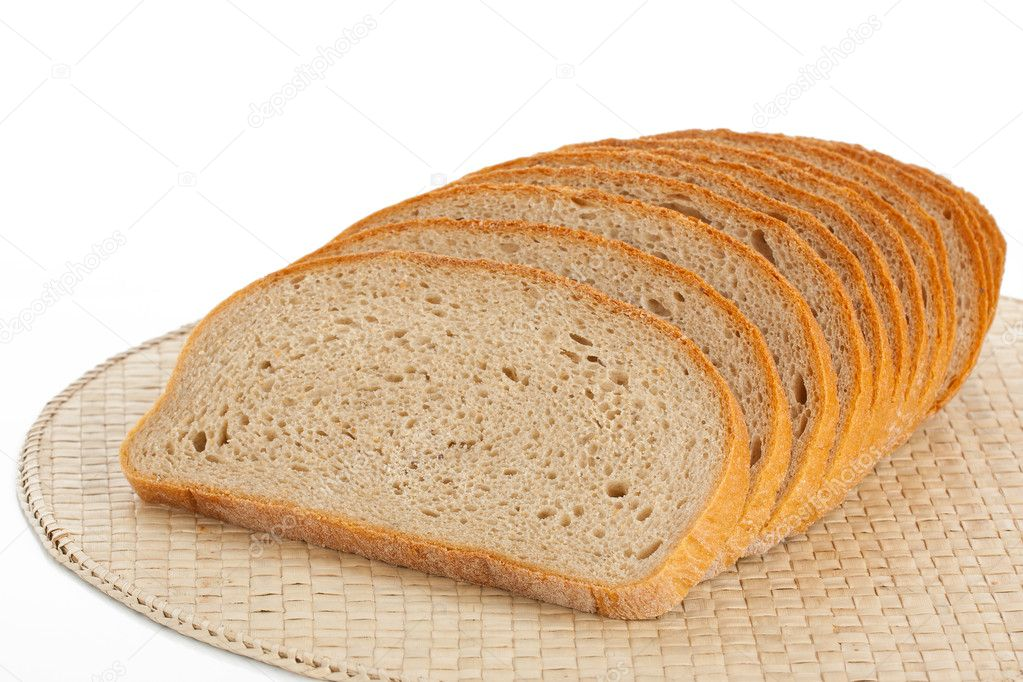 Fresh bread sliced on a place mats isolated on white — Stock Photo #10106560