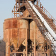 Stock Photo: Belt conveyors and silos in gravel pit in winter