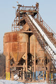 Belt conveyors and silos in a gravel pit in winter — Stock Photo