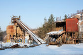 Gravel quarry, belt conveyors and silos in winter — Stock Photo
