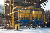Stone quarry with silos, conveyor belts in winter — Stock Photo