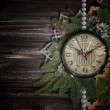 Stock Photo: Antique clock face with pearls, lace and firtree on the wooden b