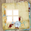 Old shabby style  photoalbum with paper frames for photos - Stock Photo