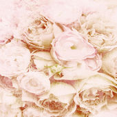 Textured background with beige roses and space for text — Stock Photo