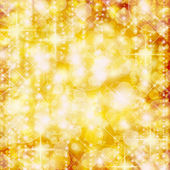 Background of defocussed golden lights with sparkles — Stock Photo