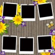 Blank instant photo frames on old wooden background — Stock Photo #9406413