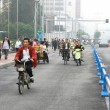 Stock Photo: Special line for bicyles, pedicabs on the multilane road, China