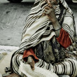 Homeless man on the street in Midoun, Djerba, Tunisia - Stock Photo