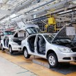 Assembling cars Skoda Octavia on conveyor line - Stock Photo