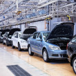 Assembling cars Skoda Octavia on conveyor line — Stock Photo #9251445