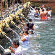 Stock Photo: Prayers during purification at Puru TirthEmpul temple, Bali