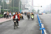 Special line for bicyles, pedicabs on the multilane road, China — Stock Photo